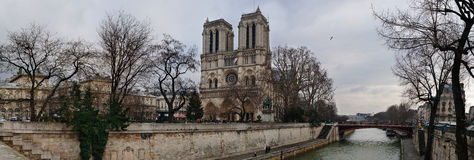 Notre Dame Paris. Panorama view of the Notre Dame catheral along the bank of the river Seine in Paris in winter royalty free stock photos
