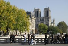 Notre Dame of Paris. Facade of the cathedral Notre Dame of Paris with buildings and trees Stock Image