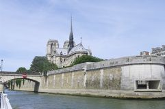 Notre Dame of Paris and the Bridge of the Archdiocese Stock Photo
