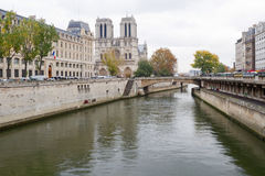 Notre Dame Of Paris And A Canal Royalty Free Stock Image