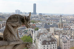 Notre Dame of Paris, famous of all Chimeras, overlooking the sky Stock Photos