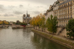 Notre Dame Paris France. Landmark and touristic spot: Gothic Notre Dame de Paris Cathedral on the the Seine river in Paris, France, by an autumn cloudy day with Royalty Free Stock Photo