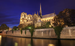 Notre Dame, Paris by Night. A photo of Notre Dame cathedral taken at dusk (blue hour) from the left bank of the river Seine Royalty Free Stock Photos