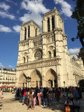 Notre Dame in Paris. Some people are hanging out and some other are waiting in the line to get in Notre Dame in Paris Stock Photography