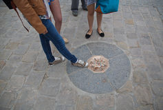 Notre Dame point zero , Paris. Point Zéro, a medallion embedded in the pavement of the parvis in front of the cathedral. (A parvis is the enclosed area or court Stock Photo