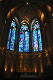 The Notre Dame of Reims. Patterned stained glass windows illuminated inside the famous Notre Dame in Reims in the Champagne area of France which is a UNESCO royalty free stock image