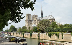 Notre Dame and the River Seine. Notre Dame cathedral from the South Bank of the river Seine near Pont de l'Archeveche and Quai de la Tournelle. The bridge on the Stock Photography