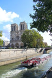 Notre Dame and Seine boat Royalty Free Stock Image