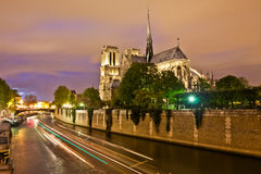 Notre Dame and the Seine at Night Stock Photo