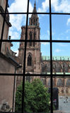 Notre Dame in Strasbourg through a window. View of the Notre Dame cathedral from a window of an opposite building in the Petite France area of Strasbourg, France stock photography