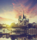 Notre Dame at sunset in Paris , France Stock Photos