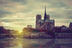 Notre Dame at sunset in Paris , France Stock Images