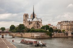 Notre Dame with  tourist boat on Seine in Paris Stock Image