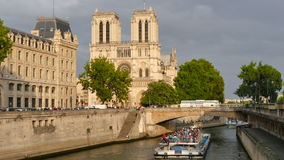 Notre Dame view from the River Seine in Paris at sunset