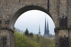 Notre Damme Cathedral in Luxembourg. Notre Damme Cathedral towers as seen through an old viaduct Royalty Free Stock Images
