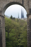 Notre Damme Cathedral in Luxembourg. Notre Damme Cathedral towers as seen through an old viaduct Royalty Free Stock Photo