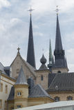 Notre Damme Cathedral in Luxembourg. Notre Damme Cathedral towers under the blue sky Stock Photo