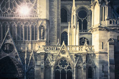 Notre de Dame de Paris. Reflection of the sun in a stained glass on the side of Notre Dame cathedral, in Paris, France Royalty Free Stock Photo