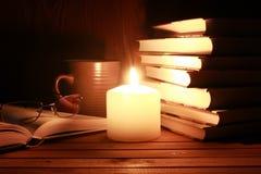Notte della candela di vetro del libro Immagine Stock Libera da Diritti