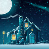 Notte di inverno con una casa e una lanterna favolose Immagine Stock