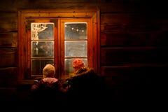Notte di Natale nella casa della Santa Fotografia Stock