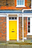 Notting   hill  area  in  england old   yellow  wall Stock Photo