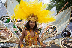 Notting Hill Carnival 2011. A pretty female girl in a float at the notting hill carnival parade Royalty Free Stock Photography