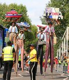 Notting Hill Carnival Colorful stilt walkers dancing royalty free stock photo
