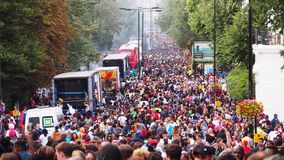 Notting Hill Carnival crowd. London, UK - August 10, 2014: Crowds gather to dance, eat, and celebrate the Notting Hill Carnival Royalty Free Stock Image