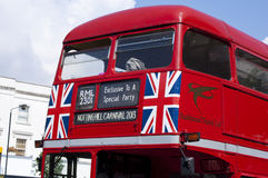 Notting hill carnival. Double red bus Stock Image