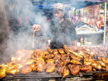 Notting Hill Carnival in London man cooking chicken outside Royalty Free Stock Photography