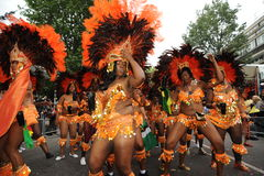 Notting Hill Carnival London 2012. Photograph of carnival participants at Notting Hill Carnival London wearing traditional head dress and Caribbean festival Royalty Free Stock Photo