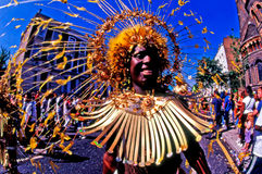 Notting Hill Carnival in London UK. LONDON - AUG 29: Performer takes part in the Notting Hill Carnival on August 29 2000 in London, England. It's the largest Stock Photos