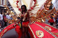 Notting Hill Carnival - red woman Stock Image