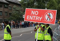 Notting Hill Carnival Security guards with forbidden pass sign royalty free stock images