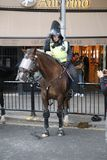 NOTTING HILL, LONDON - AUGUST 27, 2018: Mounted Riot Police Officer on horseback looks exhausted at the end of Notting Hill Carniv stock images