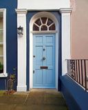 Notting hill, London, entrance with light blue arched door. Notting hill, London, colorful cozy entrance with light blue arched door Stock Image