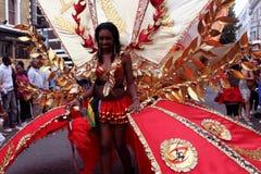 Notting- Hillkarneval - rote Frau Stockbild