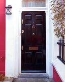 Notting wzgórze, Londyn, kolorowy rocznika domu czerni drzwi Obrazy Stock