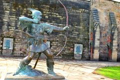 Nottingham Castle. Medieval statue of Robin Hood in front of the Nottingham Castle in England Royalty Free Stock Photo