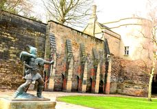 Nottingham Castle. Medieval statue of Robin Hood in front of the Nottingham Castle in England royalty free stock image