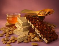 Nougat almonds. Nougat made with honey, almonds and chocolate Stock Photography