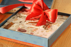 Nougat. S with fruits and nuts. Sweet gift stock image