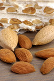 Nougat. Of almonds in background of wood Royalty Free Stock Images