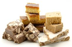 Nougat of almond. Typical Christmas sweet of Spain surrounded by white background Stock Images