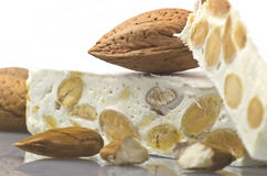 Nougat with almonds. On the white Royalty Free Stock Photo