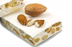Nougat with almonds. On the white Stock Image