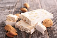 Nougat. With almonds on wood background Stock Image