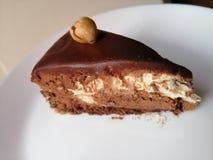 Nougat cake with chocholate on white plate. Picture of nougat chocholate cake on white plate stock photo