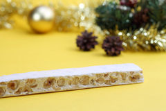 Nougat and Christmas decorations Royalty Free Stock Photo